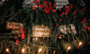 Flowers and candles are seen on the memorial of 'Сhernobyl heroes' during a ceremony in Kiev.
