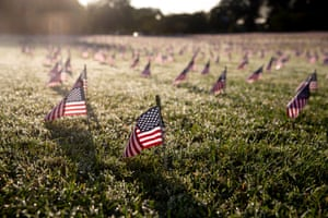 Thousands of US national flags are placed to memorialize Americans that died with Covid-19; near the base of the Washington Monument.