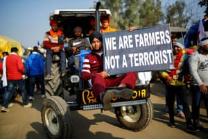 Farmers arrive in a tractor to attend a protest at Singhu