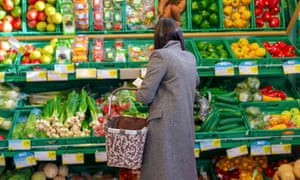 Woman shopping for fruit and vegetables in supermarket