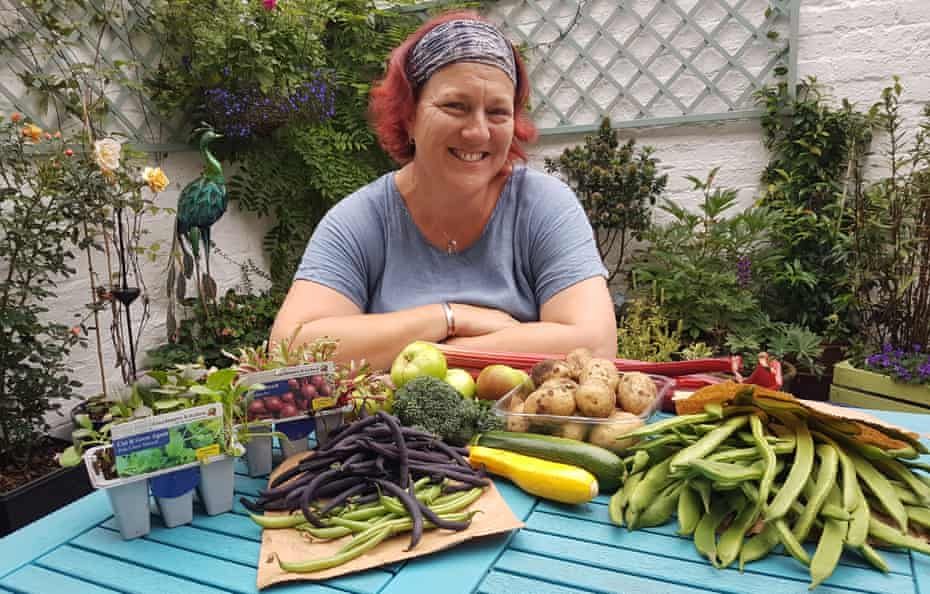 Ginnie O'Farrell with her homegrown produce, the surplus of which she donates to the fresh food bank.