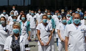 """The coronavirus disease (COVID-19) outbreak in LiegeHealthcare workers, nurses and doctors, unified under the movement called """"Take Care of Care"""" wearing face masks protest against the Belgian authorities' management of the coronavirus disease (COVID-19) crisis, at the MontLegia CHC Hospital in Liege, Belgium, May 15, 2020."""
