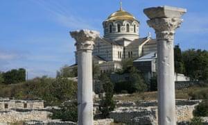 St. Vladimir cathedral is seen through ancient columns at Chersonesos ruins near Sevastopol, Crimea.