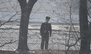 A North Korean soldier walks on the river bank on the border with China. Campaigners are concerned that defectors from the North may be sent back by Beijing.<br>