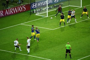 Germany's Toni Kroos whips a shot goalwards and scores.