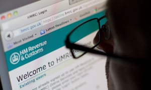 man looking at H M revenue and customs website
