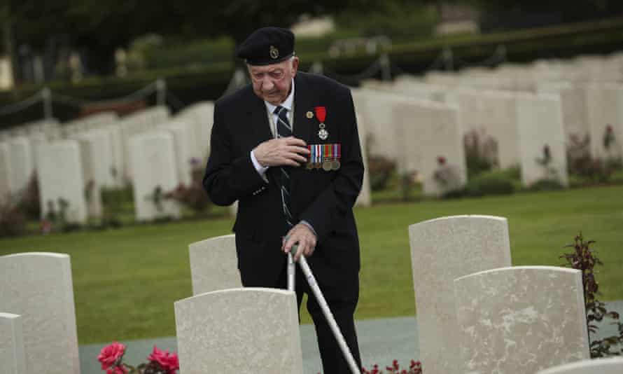 A British veteran at the Bayeux war cemetery in Normandy
