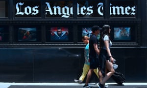 Los Angeles Times sign and pedestrians