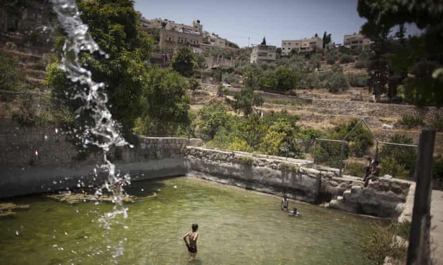 Palestinian children swim in the spring in the West Bank village of Battir.