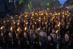 People take part in a torchlight procession as they mark the 104th anniversary of the killing of 1.5 million Armenians by Ottoman forces, Yerevan, Armenia.