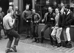 Teenage skinheads, some in white polo shirts, in London, 1980.