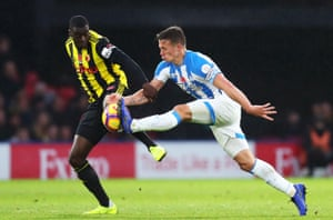 Jonathan Hogg of Huddersfield Town controls the ball while under pressure from Watford's Ken Sema at Vicarage Road. Watford win the game 3-0, sending Town to the bottom of the table.