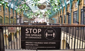 A 'Stop The Spread of Coronavirus' sign at a closed and empty Covent Garden Market, as England's second national lockdown.