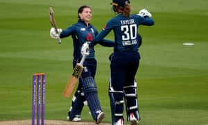 England's Tammy Beaumont  celebrates her century with Sarah Taylor during the second ODI at Hove, where there were three centurions for the first time in the women's one-day game.