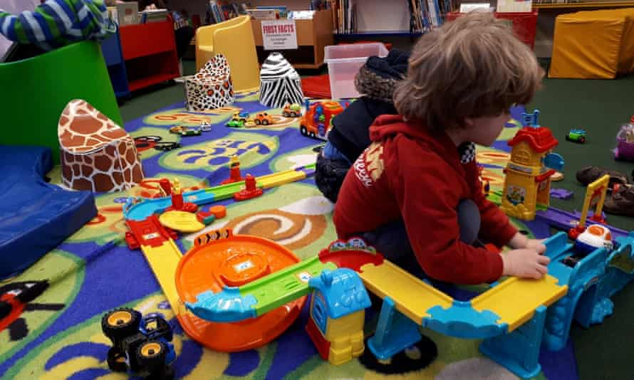 Young children playing with toys in a library