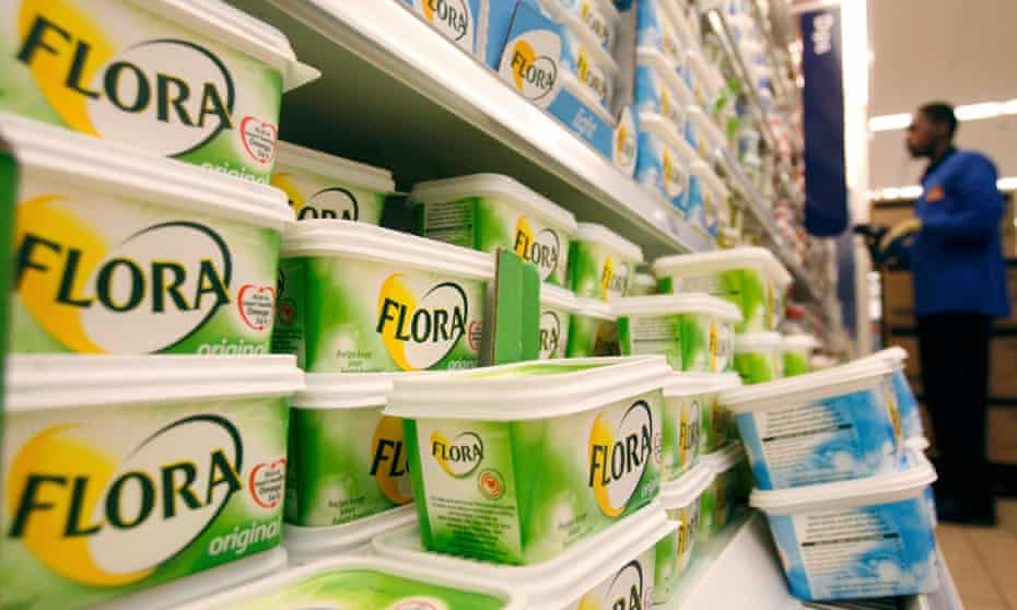 Rows of Flora margarine tubs on a supermarket shelves