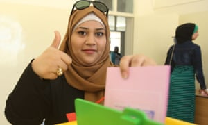 A woman is seen at a polling station in Amman,  the Jordanian capital, after casting her vote in parliamentary elections