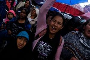 Women of the Kokonuko community accompany Efigenia Vasquez's coffin