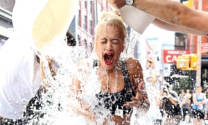 Singer Rita Ora does the ice bucket challenge on the street in New York City.