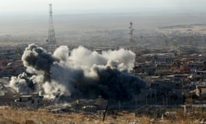 Smoke rises after an airstrike in Sinjar on Thursday