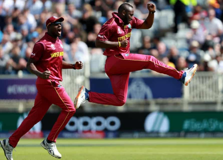 West Indies' Andre Russell celebrates dismissing Usman Khawaja of Australia