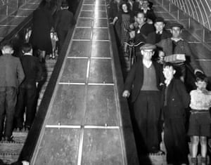 July 1951. Crowds of people using the escalators during the opening day