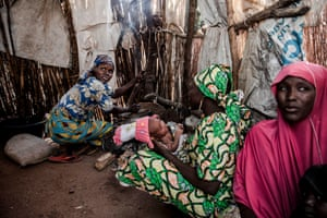 A woman cooks inside her home at Malkohi refugee camp in Jimeta, Adamawa state