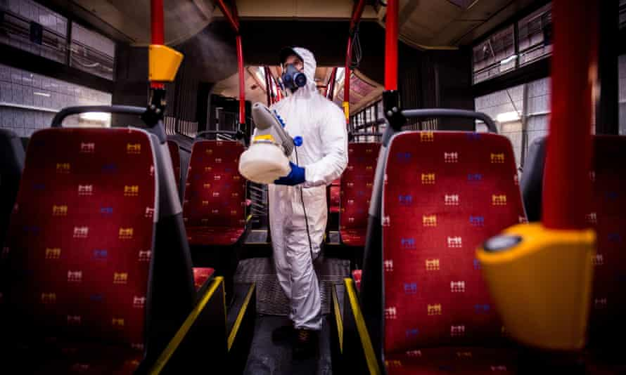 A worker in protective clothing disinfects the interior of a public bus in Bratislava, Slovakia.