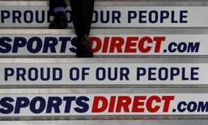 a man climbs steps with sports direct slogans such as 'proud of our people'