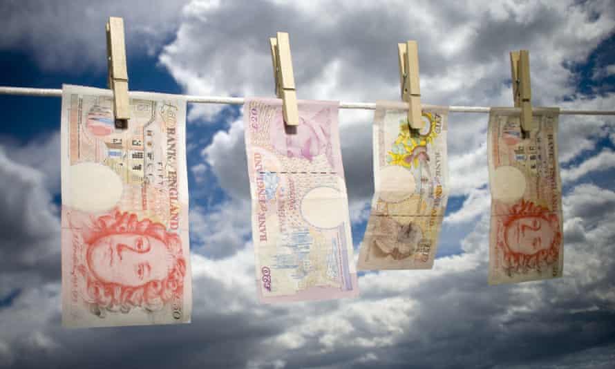 English bank notes hanging on washing line