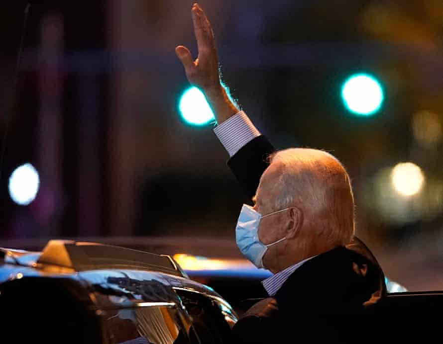 Joe Biden waves to a crowd gathered outside of The Queen theater in Wilmington, Delaware.