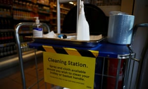 A cleaning station is seen in a Tesco supermarket in London