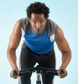 Man Riding Exercise Bicycle