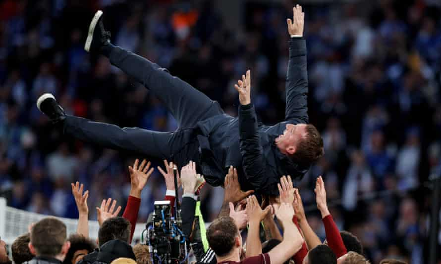 Brendan Rogers is hoisted in the air by his Leicester City players after the FA Cup Final win over Chelsea.