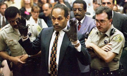 OJ Simpson at his trial for murder in 1995, wearing a pair of gloves, one of which was found at the scene of the crime.