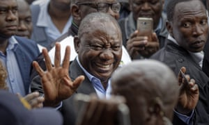 President Cyril Ramaphosa greets supporters after casting his vote in Soweto, Johannesburg.