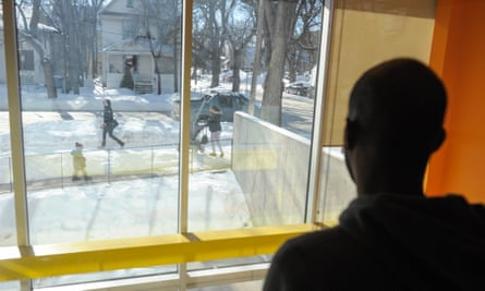 A refugee claimant from Djibouti looks out the window of the Manitoba Interfaith Immigration Council shelter on 9 February after arriving with a group of other migrants that illegally crossed the US-Canada border to seek asylum in Canada.
