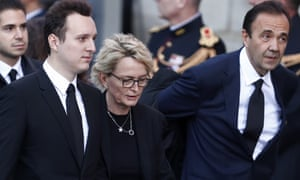 Jacques Chirac's daughter Claude, flanked by her husband Frederic Salat-Baroux (R) and her son Martin Rey Chirac at the memorial service at Saint-Sulpice.
