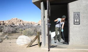 Volunteer Alexandra Degen cleans a restroom at Joshua Tree National Park on 4 January during the government shutdown.
