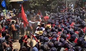 Police scuffle with student protesters during a crackdown.