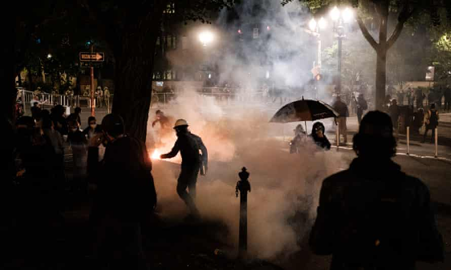 Federal officers use teargas and other crowd dispersal munitions on protesters in Portland, Oregon, on 17 July.