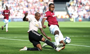 Issa Diop of West Ham United intercepts Ashley Young of Manchester United.