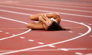 Katarina Johnson-Thompson of Britain reacts after falling due to an achilles injury in her 200m heat of the heptathlon.