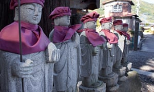 A row of Jizo statues at the entrance of Kaigenji temple. Kaigenji is a 300-year-old Buddhist temple in Chikuma, Nagano prefecture, Japan.