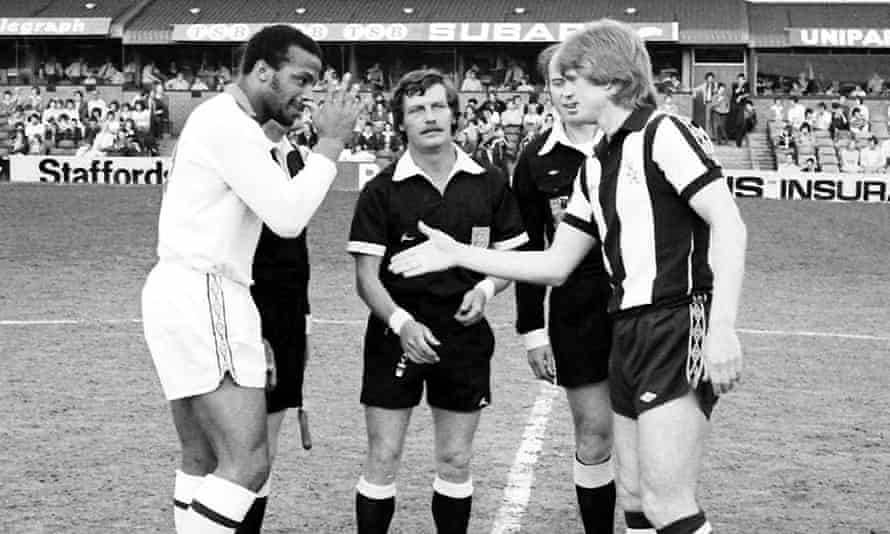 Captains Cyrille Regis and Len Cantello shake hands before Cantello's 1979 testimonial match.