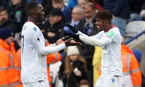 Wilfried Zaha celebrates scoring Crystal Palace's second goal of the game with Christian Benteke.