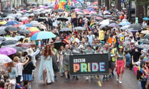 Crowds watch as members of the BBC march for the first time in the Belfast Pride parade.