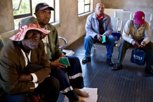 Men listen to a talk about the risks and implications of HIV infection in Khotla Clinic