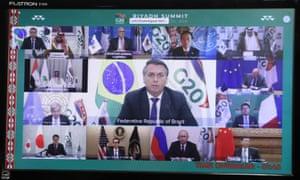 Brazilian president Jair Bolsonaro, centre, during the virtual G20 summit via a videoconference from Planalto Palace in Brasilia on 21 November.