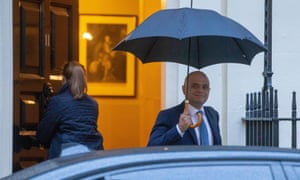 Chancellor Sajid Javid leaves No11 Downing Street in the rain